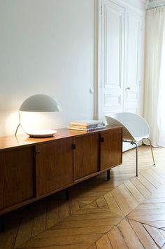 Wood + white. Chevron floors + sleek mid century modern pieces