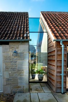 The Stables used a between the new extension and the farmhouse to create a connection. The Stables used a between the new extension and the farmhouse to create a connection. Garage Extension, Cottage Extension, Building Extension, Glass Extension, Architecture Extension, Architecture Renovation, Barn Renovation, Architecture Design, Glass Building
