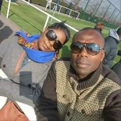 Our client Maxine is enjoying a sunny day in London with her husband @kofi_laing showing her exquisite style in our Anomabu scarf. Available at http://nanayawdesigns.com/