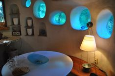 earthbag homes interiors - I wonder how they get the round windows with earthbag... Sme cob or just plaster?