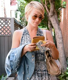 Bold fashion: Both the cell phone case and dress were of navy-and-white prints...