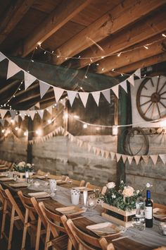 Table settings for a festival inspired farm wedding in shades of peach. Photography by Rosie Hardy and Adam Bird.