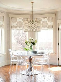 Alice Lane Home - dining rooms - Oly Studio Serena Drum Chandelier, Oly Studio Luca Dining Table, bay window - I like the pendant light and window treatments. Bay Window Treatments, Window Coverings, Living Room Window Treatments, Alice Lane Home, Design Retro, Dining Chairs, Dining Table, Dining Rooms, Lucite Chairs