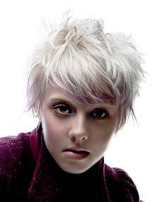 A short blonde straight coloured white hairstyle by Joico