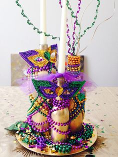 My Mardi Gras Centerpiece: glued beads to gold spray painted bottles and lots of Mardi Gras Confetti! FUN