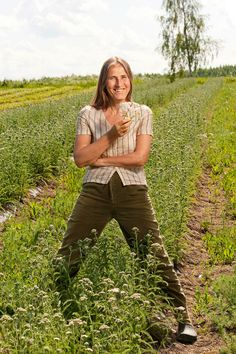 Founder Virpi Raipala-Cormier in field of yarrow. Yarrow is a one of the key ingredients in Frantsila products.