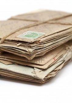 Stock Photo - Stack of old letters, over white background. Air mail, postcards and typed letters