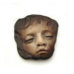 Dark Faux Bone Odd Dream Face Cab Polymer Clay by graphixoutpost, $8.50