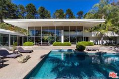 Bask in the Enormous Glass Walls and Inviting Blue Pool of This 1962 Modern in Trousdale - New to Market - Curbed LA