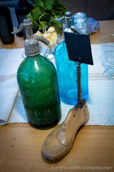 Blue & green vintage seltzer bottles and shoe form card display tabletop items from Vintage Ambiance | Photo by  Mike
