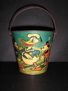 ( I want this pail ) 5 tall sand pail with a fantastic Donald Duck with Minnie , Mickey Mouse and Ferdinand the Bull with Matadors. Signed Willow, from Australia. Vintage Cartoon, Vintage Disney, Ferdinand The Bulls, Cupcake Dolls, Tin Toys, Children's Toys, Beach Toys, Beach Signs, Vintage Tins