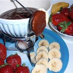 Chocolate fondue with a twist - this classic is infused with Amarula liqueur from South Africa. Serve with fresh fruits and biscuits and your guests will be infinitely impressed. Chocolate Liqueur, Chocolate Desserts, Melting Chocolate, Chocolate Heaven, Chocolates, Biscuits, Fondue Recipes, Fondue Ideas, Good Food