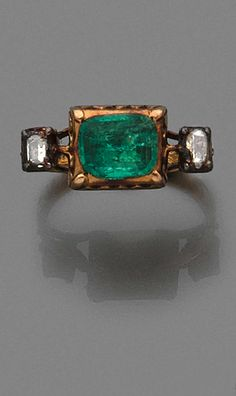 A diamond, emerald and 18K gold Renaissance ring.