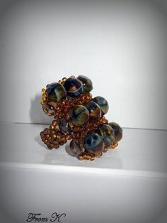 """Picasso stone"" like crystal beaded Dress up any outfit with this dramatic and elegant hand beaded glass crystals and seed beads ring. Very unique ""Picasso stone"" crystals used. About cm big Ron Crystal Beads, Glass Beads, Crystals, Beaded Rings, Wire Work, Picasso, Seed Beads, Beading, Shops"