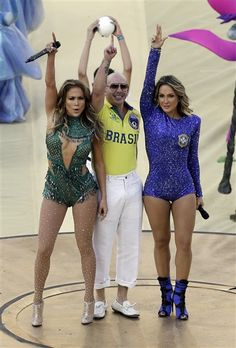 Jennifer Lopez, Brazilian singer Claudia Leitte and rapper Pitbull perform during the opening ceremony of the World Cup in the Itaquerao Stadium in Sao Paulo, Brazil, on June 12, 2014.RELATED: Pop stars who date backup dancers