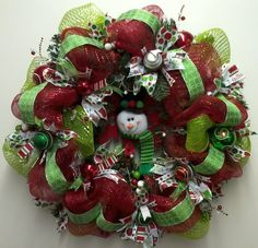 Snowman in the middle wreath  Your Beautiful Mesh Wreaths!!! Bebe'!!! Love this snowman wreath!!!
