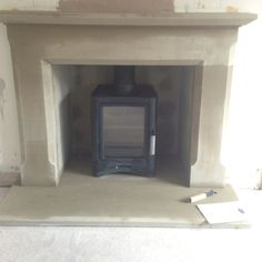 Created a large opening, Supplied & fitted a Stone surround and hearth with a Broseley evolution 5 woodburning stove.