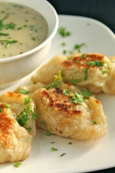 Potato Cheese Pierogis - traditional Polish dumplings updated with rich, creamy, sour cream and chive sauce Our favorite potato and cheese pierogi recipe - perfect for entertaining and easy to make in advance! I Love Food, Good Food, Yummy Food, Appetizer Recipes, Dinner Recipes, Appetizers, Pierogi Recipe, Pierogi Sauce, Vegetarian Recipes