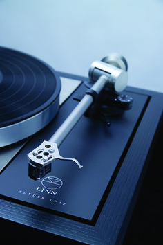 The iconic Sondek LP12 turntable with a beautiful black ash wooden plinth