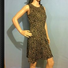 Michael Kors Leopard Cheetah Tank Dress Fierce and Sexy fit to flow dress. Full gold statement zipper down back center. Also, fun zippers on shoulders. Comfortable stretch fabric to flatter anybody's shape! 💌Thank You for your Interest!!😘 ❌NO Trades❌ 💲Price Negotiable, Use the Bundle Discount: 4️⃣Items=20%OFF!! ✨Can't find 4️⃣you like? Ask me to make you a custom BUNDLE. Michael Kors Dresses