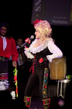 Dolly Parton looks amazing in her Zeyzani One of a Kind Boots and designed pants!