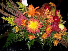 A cornucopia overflowing with  fruit, and florals! Check us out on Facebook: Moose Lake Florists/Endless Tan