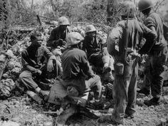 African Americans in the US Navy   Group of CBs acting as stretcher bearers for the 7th Marines. Peleliu. September 1944. Sgt. McBride. 127-N-96475