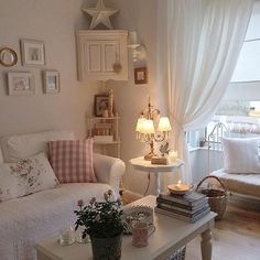 shabby picture frames, a small cabinet and some pretty accessories