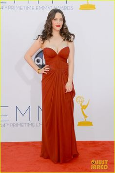 Kat Dennings looks pretty in this red shade from J. Mendel - the gathering in the middle is sort of weird, no?