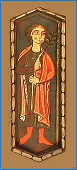 En este hexágono se puede ver a un hombre de pie, vestido con capa, que señala con el dedo de la mano derecha una rama que sostiene con la izquierda.