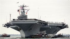 The US has pulled out a nuclear-powered aircraft carrier of the Persian Gulf as Russian warships enter the area.