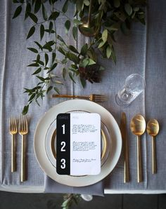 a modern minimalist table setting of our gold flatware and @vintageplate's White Collection. Photo by @cstonephotokc at River Market Event Place
