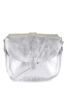 Leather saddle shape silver cross body with metalic finish. W: H: Leather Cow. Saks Off Fifth, Things To Buy, Stuff To Buy, Wands, Saddle Bags, Neiman Marcus, Topshop, Handbags, Leather