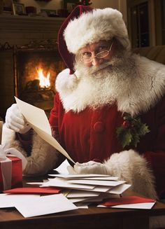 Santa Clause reading the childrens mails