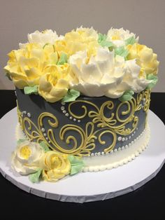 Round buttercream scroll and flower cake