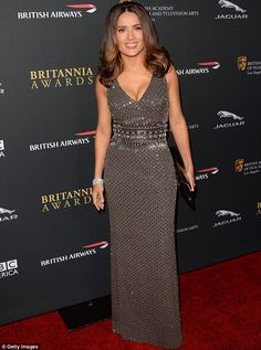 Salma Hayek shimmered in a grey sequin gown as she attended the BAFTA Britannia Awards in Beverly Hills on Saturday
