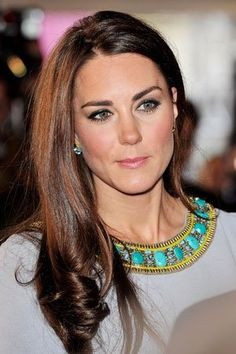 When wearing a top like this you shouldn't also wear a necklace but the small earrings is a very good idea. Kate Middleton style
