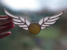 A golden snitch suncatcher, perfect for that Potter fan we all know! It measures approximately 19cm from tip to tip, and about 9cm in height.  These are made to order so please allow 7 days to produce your item.