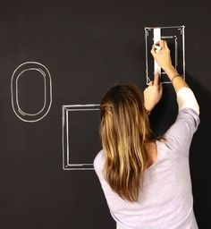 A chalkboard wall provides the perfect base for drawing selfie frames and adding personality to a bedroom.