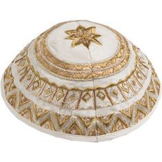 Embroidered Kippah - Geometrical White Gold of $14.00 only. This soft, elegant kippah is a beautiful way to express your Judaism as well as your style. This beautiful cream kippa is embroidered in a classic gold geometric pattern.It would be a wonderful present for a Bar or Bat Mitzvah, birthdays, or for any Jewish Holiday.  For more info visit http://yarmulkes.com/system/scripts/