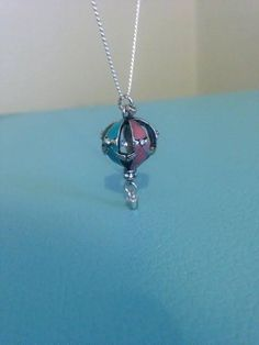 A personal favorite from my Etsy shop https://www.etsy.com/listing/524658270/hot-air-balloon-necklace