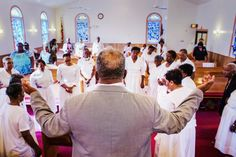 Members of the Singing and Praying Bands sing at Memorial St. Mark United Methodist Church in Edgewater. The singing style is one of the oldest surviving forms of African American music.