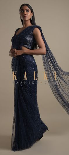 Buy Online from the link below. We ship worldwide (Free Shipping over US$100)  Click Anywhere to Tag Navy Blue Ready Pleated Saree In Net With Sequins And Beads Embroidered Striped Pattern Online - Kalki Fashion Navy blue ready pleated saree in net with sequins and beads embroidered striped pattern.Paired with a sleeveless blouse in sequins fabric.