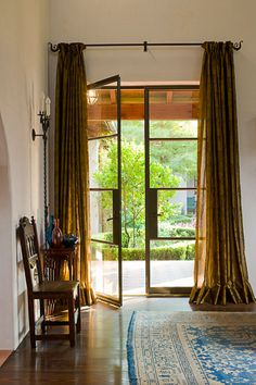 home, residential, foyer, living room, steel french doors, floor to ceiling curtains, rug