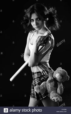 studio shot on black background: young woman holding bloody axe (axe girl) Stock Photo