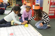 Kindergartners at Woodlands Elementary learning how to code on BeeBots!