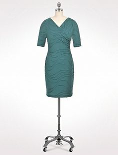 """roz & Ali drape dress.  Red haired lady on """"Mad Men"""" style dress, lots of good reviews.  A jade/forest green.  Interesting swirly pattern"""