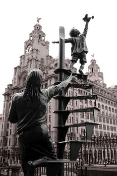 The Liverpool Blitz Memorial to the Liverpool civilians killed by German bombers during WWII. The bronze statue by Tom Murphy is in St Nicolas Church near the Pier Head. Featuring a mother with babe in arms, beckoning her playful son to leave his toy plane + seek shelter from the bombs. Around 4000 civilians were killed + 10,000 injured – the most bombed provincial city in the country. The terrible price paid by the ordinary civilians was due to Liverpool's role in the Battle of the…