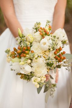 Lovely white bouquet // photo by http://bumbyphotography.com, via http://theeverylastdetail.com/rustic-chic-champagne-purple-wedding-inspiration
