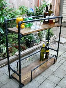 Life: Designed: DIY Pipe Bar Cart - love the industrial look - maybe try with galvanized metal instead of the black pipes